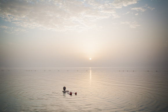 Floating in the Dead Sea, Jordan.
