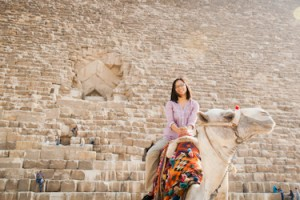 Sitting on a camel at the Pyramids, Egypt
